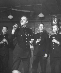 Cannon Street police relax with a game of darts in 1946 (taken from http://www.alphadeltaplus.20m.com/)